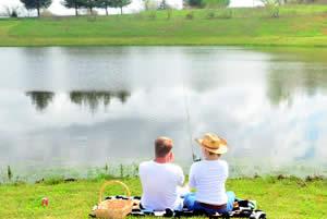 couple fishing at a lake